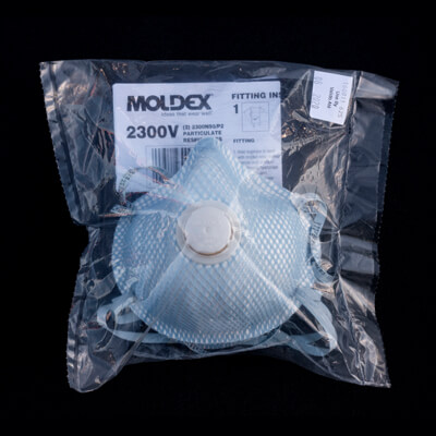plastic package that contains disposable respirator face mask